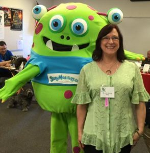 A Story Monster lurks over the authors shoulder.